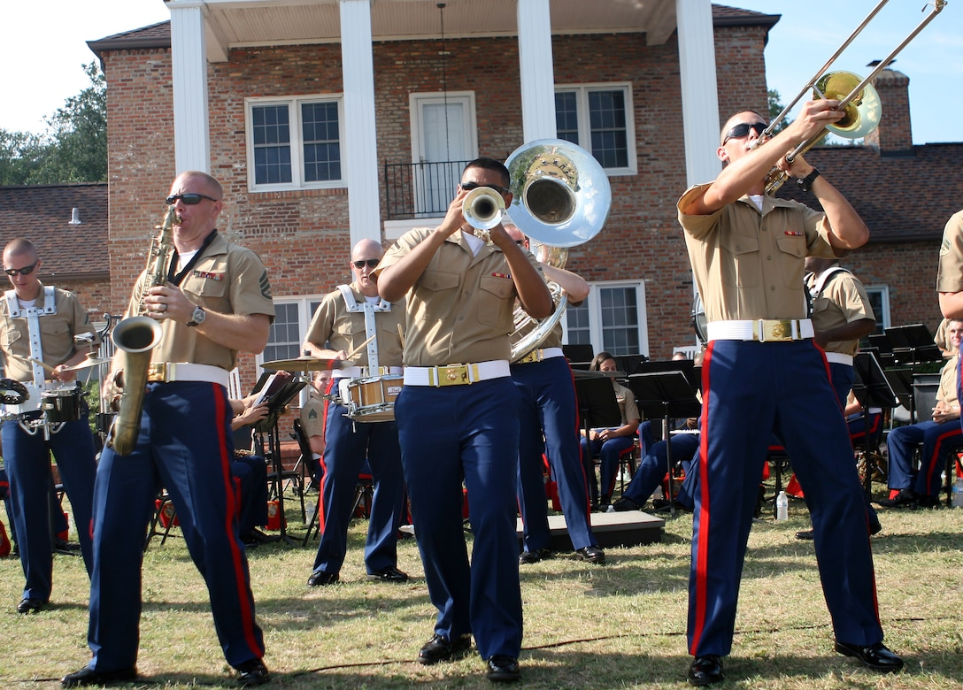 Marines from the 2nd Marine Division Brass Band pumps up the crowd at Ft. Johnston, Southport, N.C., as they perform their routine June 26, 2011. The concert opened a week-long Fourth of July celebration for the town of Southport.