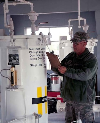 Senior Master Sgt. Cal Garlock, Fuels Superintendent, checks the separators that ensure that the jet fuel is free of contaminants, sediment, and water before it reaches the fuel trucks and the aircraft June 9. (U.S. Air Force Photo by Tech. Sgt. Heather Walsh)