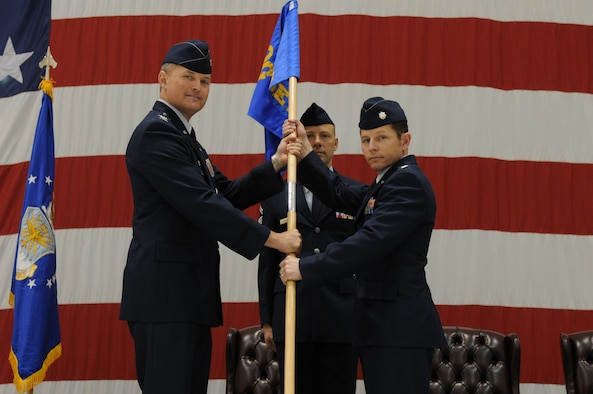 Colonel Lawrence Hoffman (left), 9th Operations Group commander passes the Detachment 3 guidon to Lt. Col. Raymond Simmons (right), newly appointed Detachment 3 commander during a change of command ceremony here, June 20.(U.S. Air Force photo/ Senior Airman Carlin Leslie)