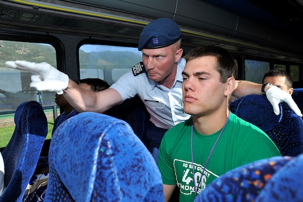Air Force Academy Cadet 1st Class Zachary Crippen instructs a basic cadet to keep his eyes forward during the bus ride from Doolittle Hall to the Terrazzo June 25, 2011. Cadet Crippen is a cadre member assigned to Cadet Squadron 12. (U.S. Air Force photo/Megan Davis)