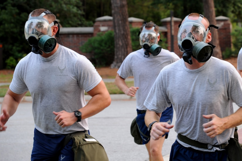 Members of the 437th Aircraft Maintenance Squadron finish their physical training session with a gas mask run June 22 at Joint Base Charleston. Members from the 437th Aerial Port Squadron and the 437 AMXS meet every Wednesday to prepare for the 2011 Air Mobility Command Rodeo scheduled for July 23 - 29 at Joint Base Lewis-McCord, Wash.    (U.S. Air Force photo/Staff Sgt. Nicole Mickle)