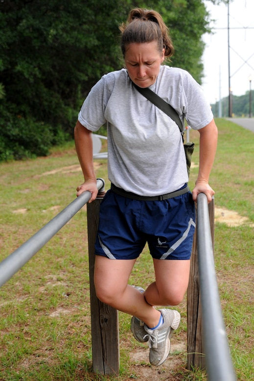 Staff Sgt. Ashley Kelly does dips on the parallel bars June 22 at Joint Base Charleston. Members from the 437th Aerial Port Squadron and the 437th Aircraft Maintenance Squadron meet every Wednesday to prepare for the 2011 Air Mobility Command Rodeo scheduled for July 23 - 29 at Joint Base Lewis-McCord, Wash.  Sergeant Kelly is from the 437 APS.  (U.S. Air Force photo/Staff Sgt. Nicole Mickle)