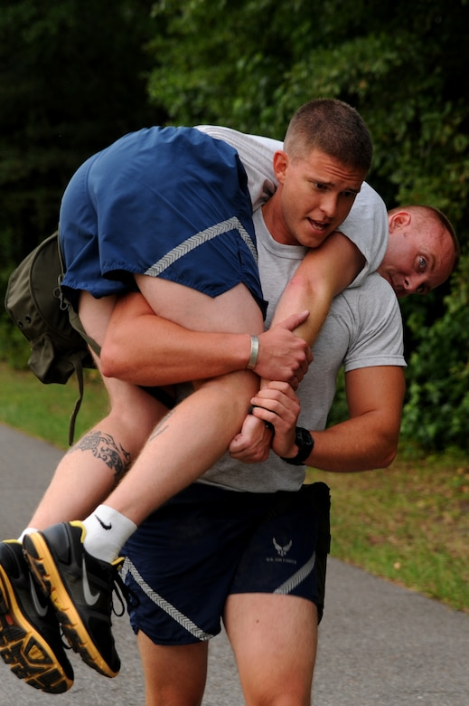 1st Lt. Travis Mongeon carries Tech. Sgt. Allen Minner June 22 at Joint Base Charleston in preparation for the upcoming Air Mobility Command Rodeo. Members from the 437th Aerial Port Squadron and the 437th Aircraft Maintenance Squadron meet every Wednesday to prepare for the competition July 23-29 at Joint Base Lewis-McCord, Wash.  Lieutenant Mongeon and Sergeant Minner are both from the 437 AMXS.  (U.S. Air Force photo/Staff Sgt. Nicole Mickle)