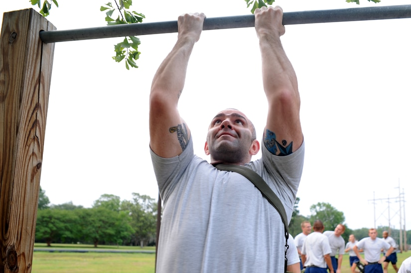 Tech. Sgt. Jason Gates does pullups June 22 at Joint Base Charleston as he prepares for the upcoming Air Mobility Command Rodeo. Sergeant Gates and other Rodeo-team members from the 437th Aerial Port Squadron and the 437th Aircraft Maintenance Squadron meet every Wednesday to prepare for the 2011 Air Mobility Command Rodeo. The competition will take place July 23-29 at Joint Base Lewis-McCord, Wash. Sergeant Gates is from the 437 APS.  (U.S. Air Force photo/Staff Sgt. Nicole Mickle)