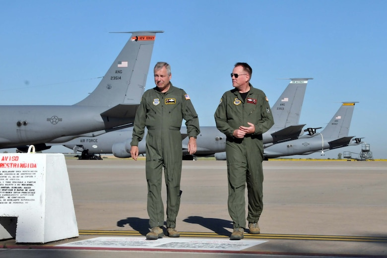 Brig. Gen. Roy E. Uptegraff, Commander 313th Air Expeditionary Wing (left) and Col. Ted Metzgar, Commander 128th Air Refueling Wing discuss dynamics of operations at the 313 AEW prior to Col. Metzgar assuming command of the wing on June 14, 2011 in Western Europe (U.S. Air Force Photo/Capt. John P. Capra)