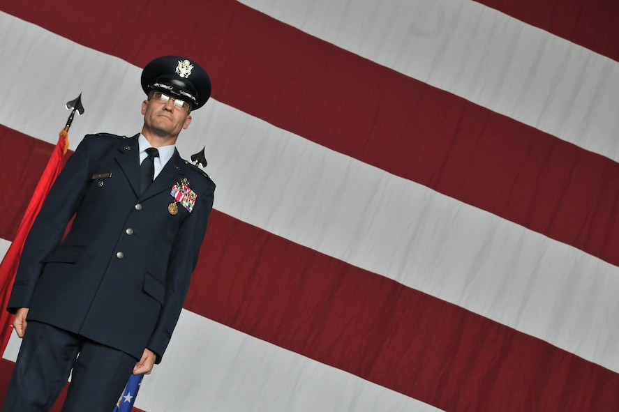 Col. Eric Gates (left), former 39th Maintenance Group commander, stands at attention during the 39th MXG inactivation ceremony June 14, 2011, in Hangar 4 at Incirlik Air Base, Turkey.  (U.S. Air Force photo by Staff Sgt. Alexandre Montes/Released)