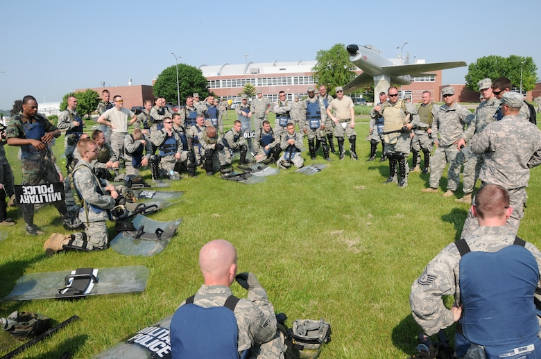 Members of the Nebraska Air National Guard Response Force team are debriefed after an exercise scenario during a National Guard Response Force training exercise held at the Nebraska Air National Guard parade grounds on June 5, 2011 in Lincoln, Neb. (Nebraska Air National Guard photo by Senior Airman James Lieth)