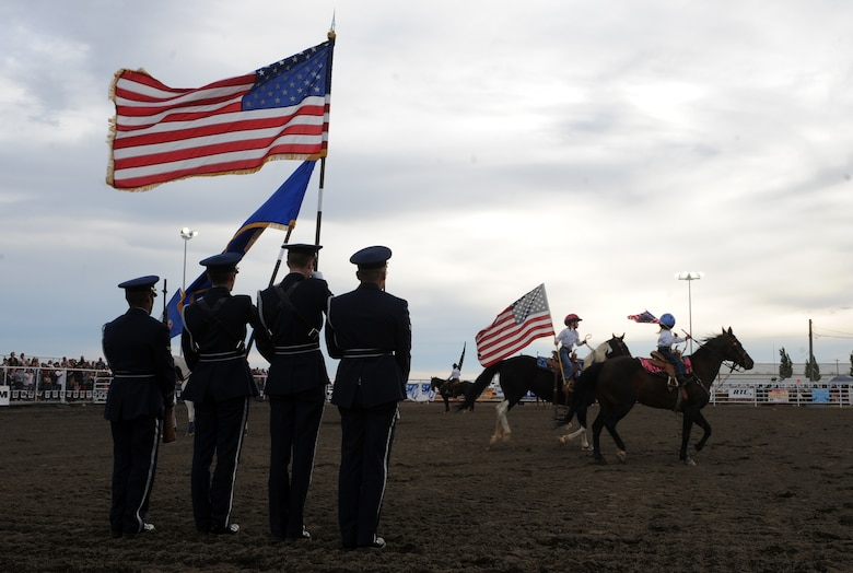 MOUNTAIN HOME, Idaho – Members of the base honor guard present the colors during the opening ceremony of the 6th annual Daniel Dopps Memorial Rodeo at Optimist Park June 25. Each year the Rodeo is held in memory of Daniel Dopps, a resident of Mountain Home, who passed away at the age of 19 from injuries sustained during a rodeo in Grace, Idaho. (U.S. Air Force photo by Senior Airman Debbie Lockhart)