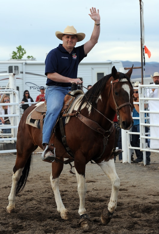MOUNTAIN HOME, Idaho – Col. Ron Buckley, 366th Fighter Wing commander, waves as he enters the arena on horseback during the 6th annual Daniel Dopps Memorial Rodeo at Optimist Park June 25. The goal of the rodeo is to raise money for charities within Mountain Home, Elmore County and the State of Idaho. (U.S. Air Force photo by Senior Airman Debbie Lockhart)
