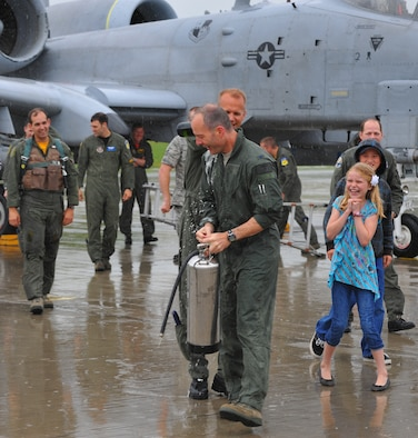 SPANGDAHLEM AIR BASE, Germany – Lt. Col. Geoffrey Maki, 52nd Operations Group, pours sparkling wine on Col. Jackson Fox, 52nd Operations Group commander, after his final flight here June 24. Colonel Fox celebrated his last A-10 Thunderbolt II flight at Spangdahlem Air Base with family, friends and coworkers before taking command of the 39th Air Base Group at Incirlik Air Base, Turkey. (U.S. Air Force photo/Airman 1st Class Dillon Davis)