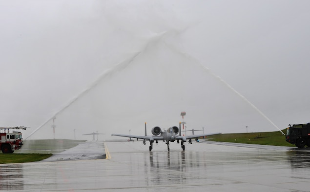 SPANGDAHLEM AIR BASE, Germany – Col. Jackson Fox, 52nd Operations Group commander, taxis an A-10 Thunderbolt II under streams of water after his final flight here June 24. Colonel Fox celebrated his last A-10 Thunderbolt II flight at Spangdahlem Air Base with family, friends and coworkers before taking command of the 39th Air Base Group at Incirlik Air Base, Turkey. (U.S. Air Force photo/Airman 1st Class Dillon Davis)