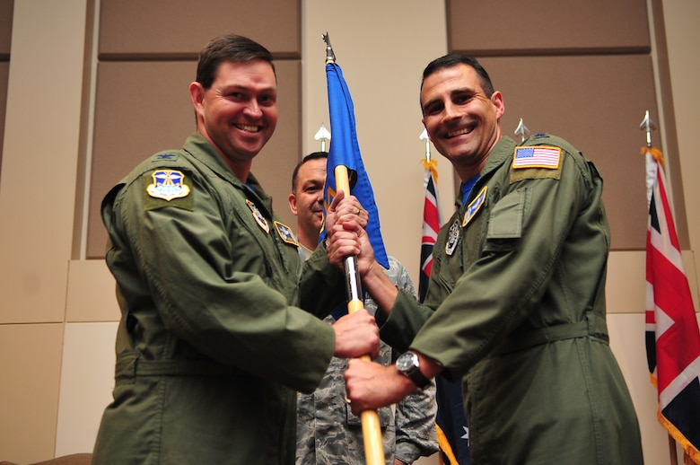 BUCKLEY AIR FORCE BASE, Colo. -- Colonel Bradley Saltzman, 460th Operations Group Commander, presents the flag standard of the 2nd Space Warning Squadron to incoming commander Lt. Col. John Henley June 24, 2011. (U.S. Air Force photo by Staff Sgt. Kathrine McDowell)