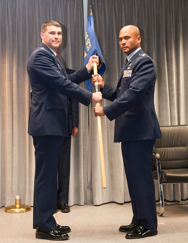 RAMSTEIN AIR BASE, Germany -- Lieutenant Col. Kelly Kanapaux, 460th Space Communications Squadron (SCS) commander, left, presents the Detachment 1, 460th SCS unit flag to incoming commander Maj. Douglas Freeman June 21, 2011. Approximately a half-dozen squadron commanders assigned to Team Buckley will change over the course of the summer months. (Courtesy Photo)