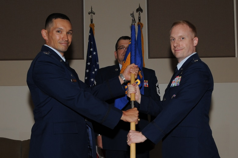 BUCKLEY AIR FORCE BASE, Colo. -- Colonel Thomas Hensley, 544th Intelligence, Surveillance and Reconnaisance Group commander, left, presents the flag standard of the 566th Intelligence Squadron to the incoming commander, Lt. Col. Adam Stone, June 24, 2011. (U.S. Air Force photo by Airman 1st Class Phillip Houk)