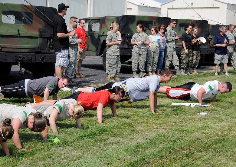 Master Sgt. Andy Vanness, a volunteer referee, forced all but the last team standing do 15 push-ups. One of the perks of being a ref. Photo by Master Sgt. John M.  Day/Released