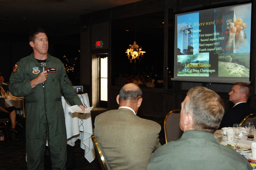 Lt. Col. Doug Champagne, commander of the 107th Fighter Squadron, Selfridge Air National Guard Base, Mich., recalls his experiences on Sept. 11, 2001, during a June 21, 2011, meeting of the Selfridge Base Community Council. Champagne was airborne in an F-16 Falcon, returning from a morning target practice mission, when the terror attacks occured. At far right is Lt, Col. Rolf Mammen, also a pilot with the Michigan Air National Guard, wore his United Airlines pilot uniform to the meeting and recalled his experiences that day flying in a United airliner, bound for New York. (USAF photo by Rachel Barton, 127th Wing Public Affairs)