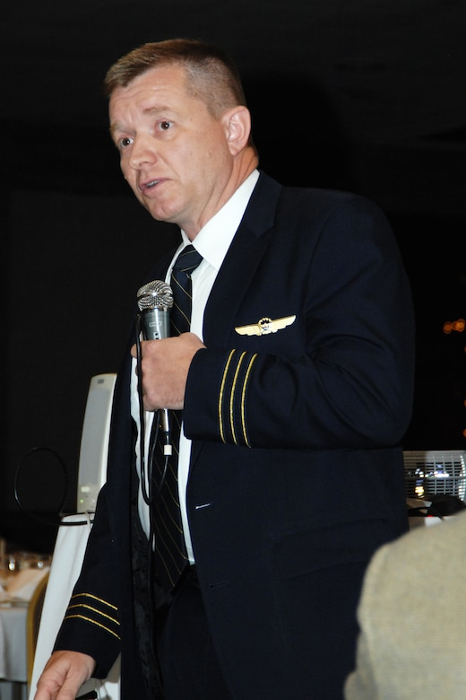 Michigan Air National Guard Lt, Col. Rolf Mammen wears his United Airlines pilot uniform as he recalls the events of Sept. 11, 2001, during a meeting of the Selfridge Base Community Council near Selfridge Air National Guard Base, June 21, 2001. Mammen, who is also a pilot with the 127th Wing, was flying in a United airliner, bound for New York, on the morning of Sept. 11. (USAF photo by Rachel Barton, 127th Wing Public Affairs)