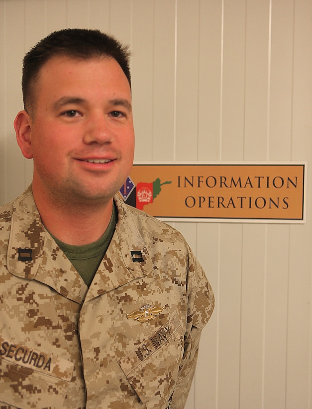 Atlanta native Navy Lt. John Securda proudly wears his Fleet Marine Force Qualified Officer insignia. The information operations planner earned his FMFQO insignia recently by successfully completing the necessary requirements, to include a six-mile hike, passing the Marine Corps Physical Fitness Test, completing a written test, and an oral board conducted by FMF-qualified officers. Securda deployed with 1st Marine Division (Forward) and will now continue to serve with 2nd MarDiv (Fwd).