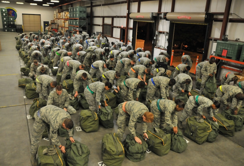 Airmen from Joint Base Charleston review their deployment bags to ensure all required items are present. They were participating in the mobility exercise conducted Feb. 24 through Feb. 26. (U.S. Air Force photo/ Airman 1st Class Jared Trimarchi)