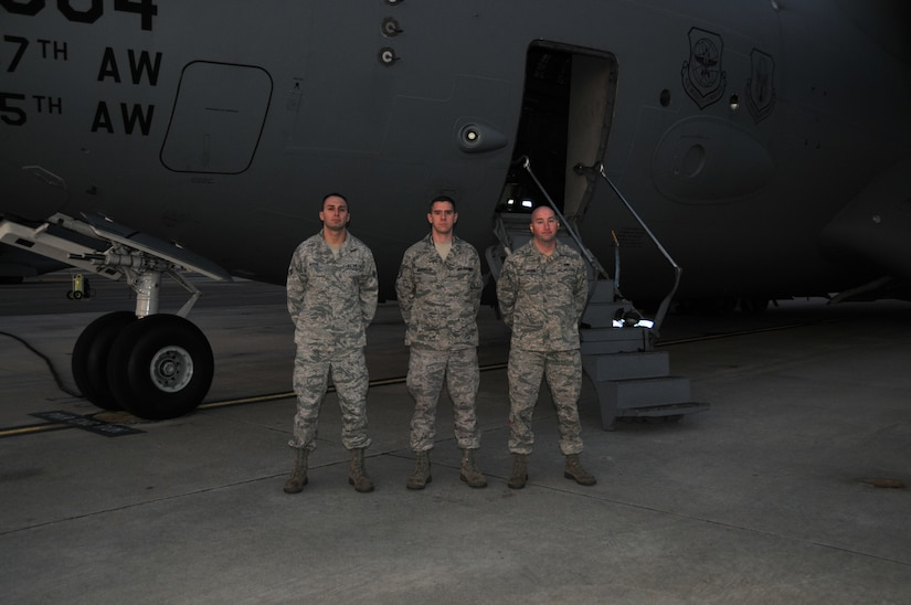 Senior Airman Jared Alessi, Staff Sgt. Jonathan Houghton and Senior Airman Grant Carson from the 437th Aircraft Maintenance Squadron pose in front of a C-17, Feb. 15. The three Airmen received medals for their acts of courage that lead to the apprehension of an intruder on Incirlik Air Bse, Turkey, in 2009. (U.S. Air Force photo/ Airman 1st Class Jared Trimarchi)