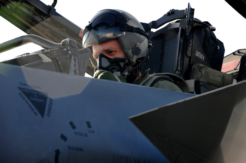 Staff Sgt. Robert Pennington sits in the cockpit of an F-15E Strike Eagle before his incentive flight, Feb. 26 on Joint Base Charleston - Air Base. The 333rd Fighter Squadron out of Seymour Johnson Air Force Base gave incentive flights to outstanding airmen from Joint Base Charleston and Seymour Johnson . Sergeant Pennington is a Propulsion Specialist with the 437th Maintenance Group. (U.S. Air Force photo/Staff Sgt. Nicole Mickle)