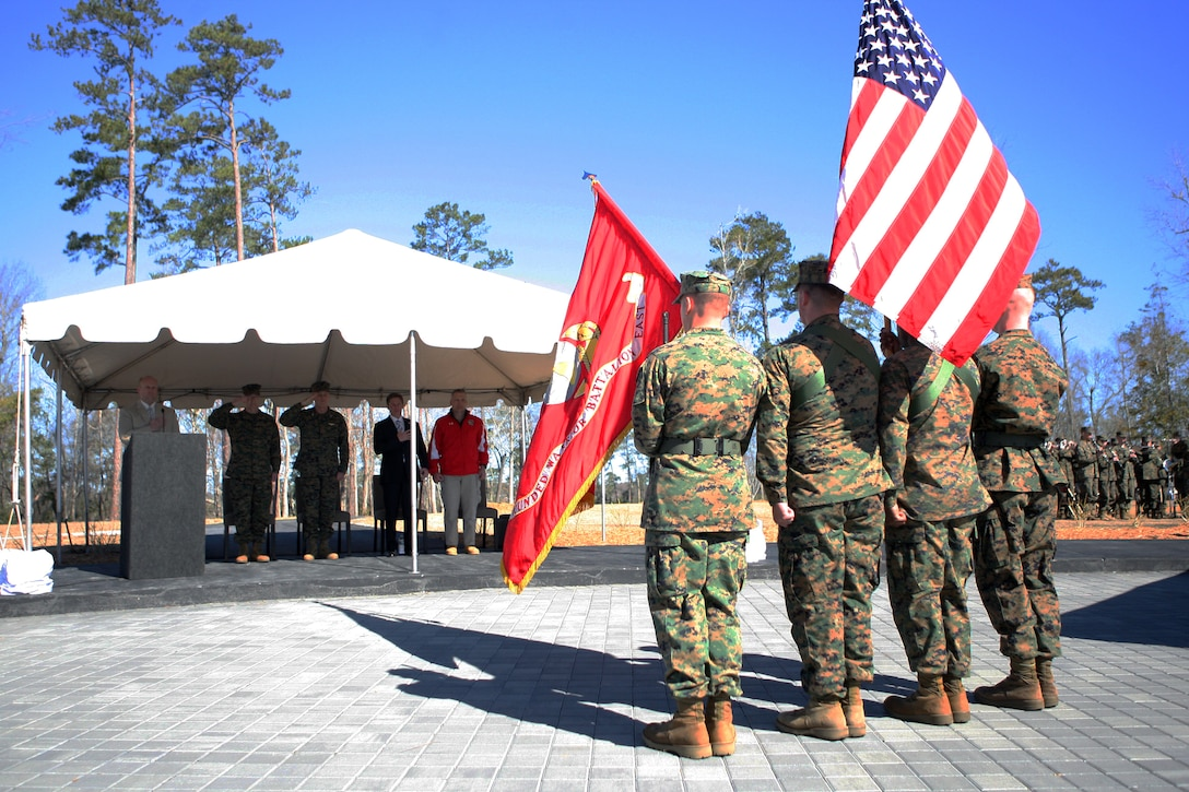 Members of the official party salute the color guard during the Fisher House and Wounded Warrior Battalion – East Bachelor Enlisted Quarters ribbon-cutting ceremony aboard Marine Corps Base Camp Lejeune, March 3.