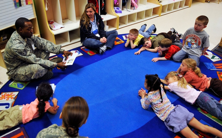 """BUCKLEY AIR FORCE BASE, Colo. -- Children at the A-Basin Child Development Center listens as TSgt Frank Henderson, 460 Medical Group teaches them about an influential women named Rosa Parks February 1, 2011.The public celebration of women's history in this country began in 1978 as """"Women's History Week"""" in Sonoma County, California. (U.S. Air Force photo by Airman 1st Class Paul Labbe.)"""