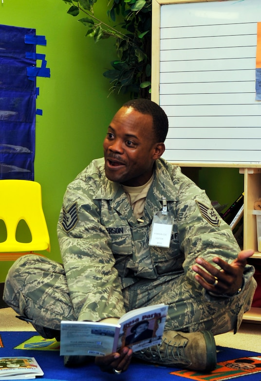 BUCKLEY AIR FORCE BASE, Colo. -- TSgt Frank Henderson, 460 Medical Group, reads about Rosa Parks to children at the A-Basin Child Development Center February 1, 2011. Sometimes we may not be able to take those field trips with our own children, we have the opportunity to come out and educate someone else's. Whenever this is the case, its always a good thing said TSgt Henderson. (U.S. Air Force photo by Airman 1st Class Paul Labbe.)