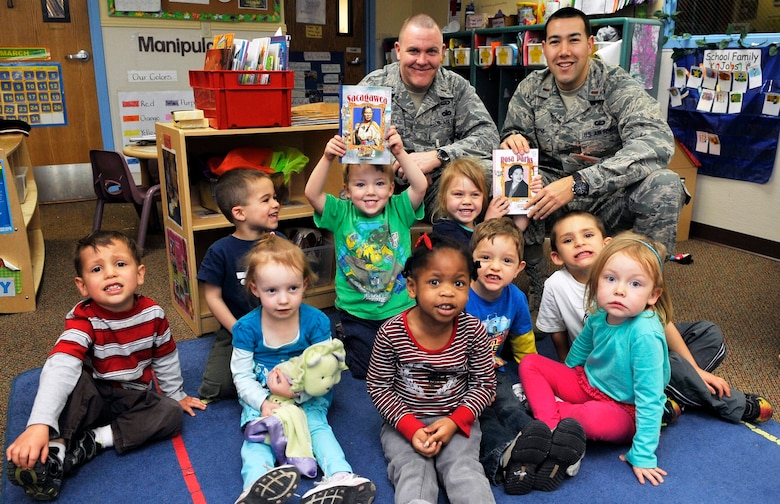 BUCKLEY AIR FORCE BASE, Colo. -- 2nd Lt. Jared Rutkovitz,460th Contracting Squadron, and 2nd Lt. John Jacob, 460th Force Support Squadron poses the children at the Crested Butte Child Development Center February 1, 2011. Volunteers read to children to spread awareness about Women History Month(U.S. Air Force photo by Airman 1st Class Paul Labbe.)