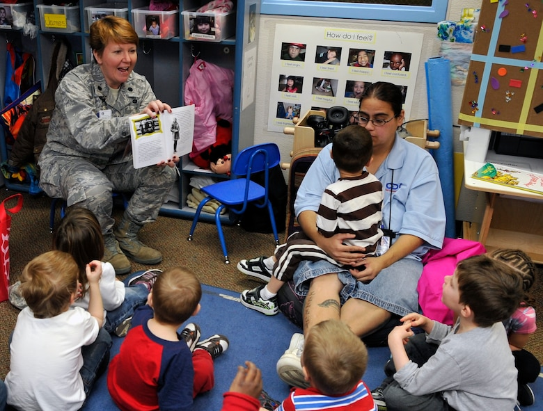 """BUCKLEY AIR FORCE BASE, Colo. -- Lt. Col. Gianna Zeh, 460 Medical Group reads about Amelia Earhart to a classroom at the Crested Butte Child Development Center February 1, 2011. """"Today we wanted to read to the children and expose them to some historic female leaders of American history said Lt. Col. Gianna R. Zeh.(U.S. Air Force photo by Airman 1st Class Paul Labbe.)"""