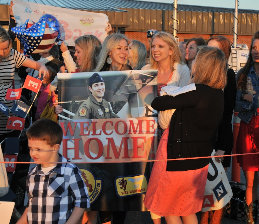 Families of deployed Airmen from the 16th Airlift Squadron await the arrival of their loved ones March 3. The 16 AS returned home from a 120 day deployment in the Middle East. (U.S. Photo/ Airman 1st Class Jared Trimarchi)