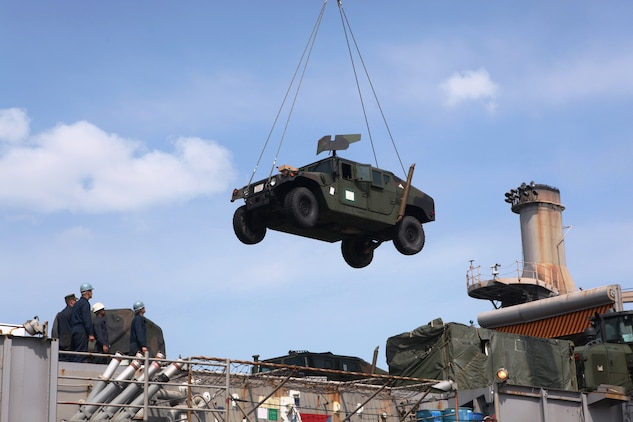 A humvee belonging to the 31st Marine Expeditionary Unit is moved from the USS Denver (LPD 9) to the USS Harpers Ferry (LSD 49), March 4.  Elements of the 31st MEU switched ships mid-deployment, allowing the MEU to remain ready to respond.  The transition comes midway through the MEU's scheduled deployment to the Asia-Pacific region, enhancing theater security and conducting bilateral training with multiple nations.  The 31st MEU is the U.S.'s only continually forward-deployed MEU, and remains a force in readiness in the Asia-Pacific region at all times.