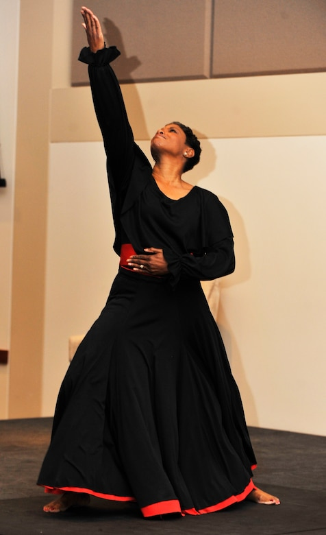 BUCKLEY AIR FORCE BASE, Colo. -- Mrs. Melody Ellis performs a spiritual dance during the Black History Month luncheon February 28, 2011. The luncheon was celebrated by a dance and songs from students of the Aurora Central High School Chorus commemorating Black History Month. (U.S. Air Force Photo By Airman 1st Class Paul Labbe.)