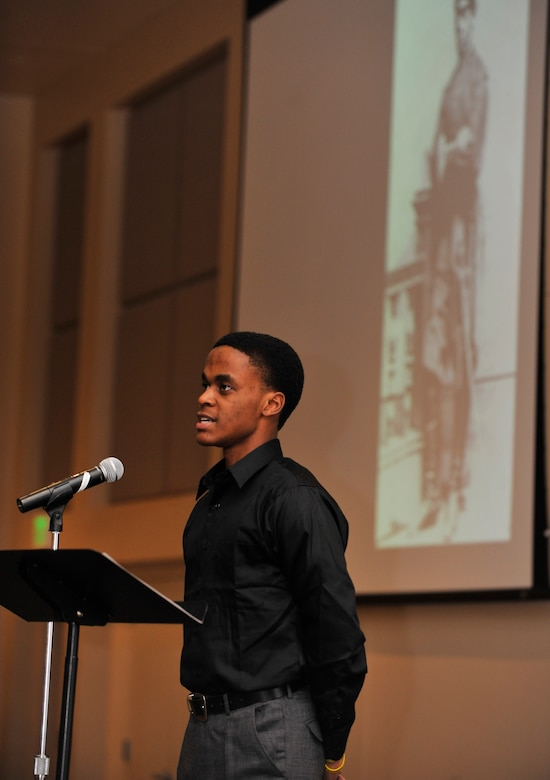 BUCKLEY AIR FORCE BASE, Colo. -- A student from the Aurora Central High school reenacts the past experiences of black leaders February 28, 2011.Students from the high school  retold the stories of the hardships, struggles, and the paths taken to overcome adversity by enlisted African American pioneers.(U.S. Air Force photo by Airman 1st Class Paul Labbe.)
