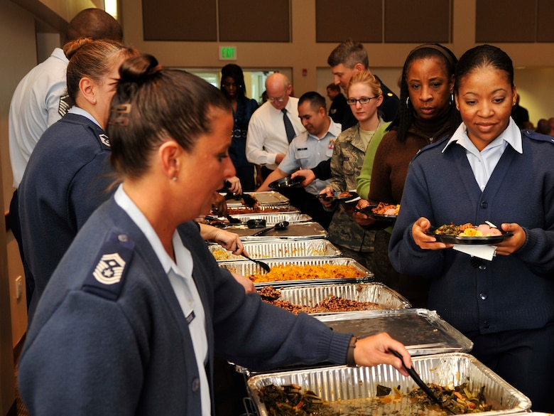 BUCKLEY AIR FORCE BASE, Colo. -- Buckley member partake in food provided at the Black History Month luncheon February 28, 2011.The food was provided by Urban Chefs Grill. (U.S. Air Force photo by Airman 1st Class Paul Labbe.)