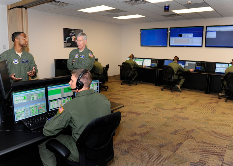 General William Shelton, Air Force Space Command commander, visits the Standard Space Trainer Integrated Training Center at Schriever Air Force Base, Feb.  25. The center trains satellite operators in a realistic setting. Spearheaded by the Space and Missile Systems Center Space Training Acquisition Office, Air Force Research Lab and AETC in 2006, the project was envisioned as a cost effective, quality training system built on a common training architecture.