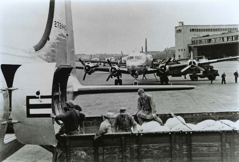 Unloading planes at Tempelhof airport during the Berlin Airlift