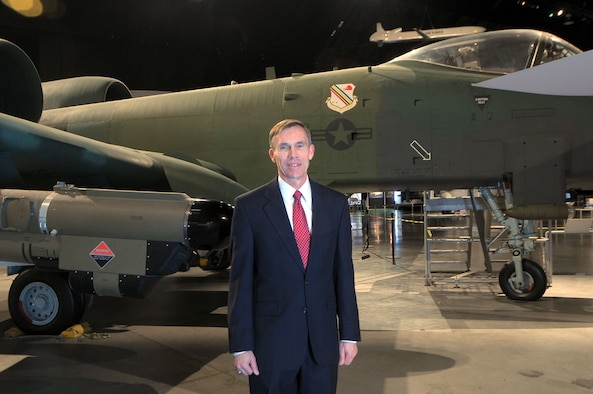 """DAYTON, Ohio -- Museum Director Lt. Gen. (Ret.) John """"Jack"""" L. Hudson stands near the A-10 in the Cold War Gallery at the National Museum of the U.S. Air Force. (Skywrighter photo by Niki Jahns)"""