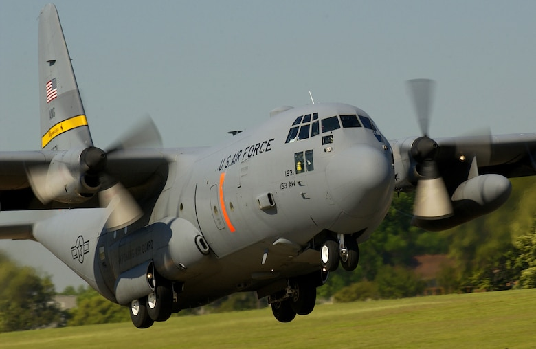 A C-130 Hercules Modular Airborne Firefighting System aircraft takes off for a mission during an annual MAFFS exercise at Donaldson Center Industrial Air Park in Greenville, S.C., on May 4, 2005.  The exercise is a one-week annual training and re-certification exercise joining air and ground personnel from the Federal Department of Agriculture's Forest Service, U.S. Air National Guard and U.S. Air Force Reserve units.  The exercise involves eight C-130 Hercules aircraft that fly continuous missions dropping water on South Carolina's Sumter National Forest to prepare crews for wild land firefighting missions.  The C-130 is assigned to the 153rd Airlift Wing, Wyoming Air National Guard in Cheyenne, Wyo.  DoD photo by Staff Sgt. Matthew Hannen, U.S. Air Force.  (Released)