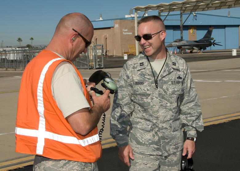 Capt. Jason Burns, a maintenance officer at the 162nd Fighter Wing, talks about maintenance issues on the flightline at Tucson International Airport. He is the Arizona Air National Guard's outstanding junior officer for 2010. (U.S. Air Force photo/Master Sgt. Dave Neve)