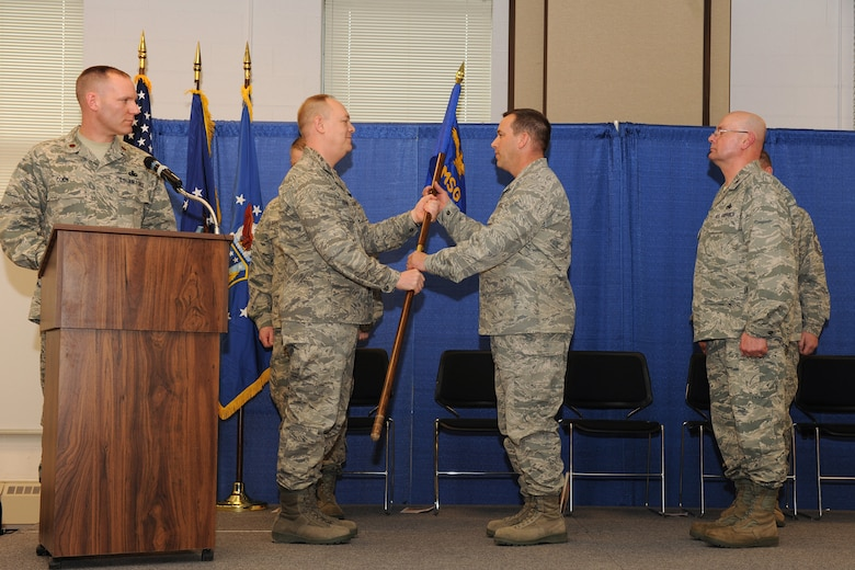 Lt. Col. Earl A. Evans accepts the 174th Fighter Wing Mission Support guidon from 174th FW Commander Col. Kevin W. Bradley during the Change of Command Ceremony during the March Unit Training Assembly. Lt. Col. Evans takes command from Col. Harvey M. Van Wie, Jr. as the 174th MSG Commander, Hancock Field Air National Guard Base, Syracuse, NY. (USAF Photo by: Staff Sgt. James N. Faso II/ RELEASED)