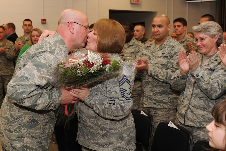 Outgoing 174th Fighter Wing Mission Support Group Commander Col. Harvey M. Van Wie, Jr. presents his wife Chief Master Sgt. Judy Van Wie with a bouquet of roses after he relinquished command of the MSG to incoming Commander Lt. Col. Earl A. Evans. Col. Van Wie has served in the military for more than 40 years and has been assigned as the Special Projects Project Officer for the 174FW. (USAF Photo by: Staff Sgt. James N. Faso II/ RELEASED)