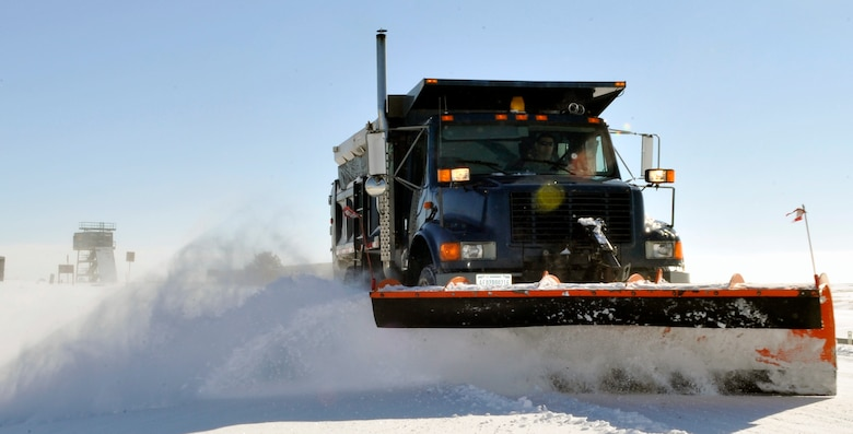 BUCKLEY AIR FORCE BASE, Colo. -- A plow truck plows snow from the road January 1, 2011. When winter weather hits Buckley AFB the 460th 460th Civil Engineering Squadron are one of the first  ones on base to make sure we arrive safely. (U.S. Air Force photo by Airman 1st Class Paul Labbe.)