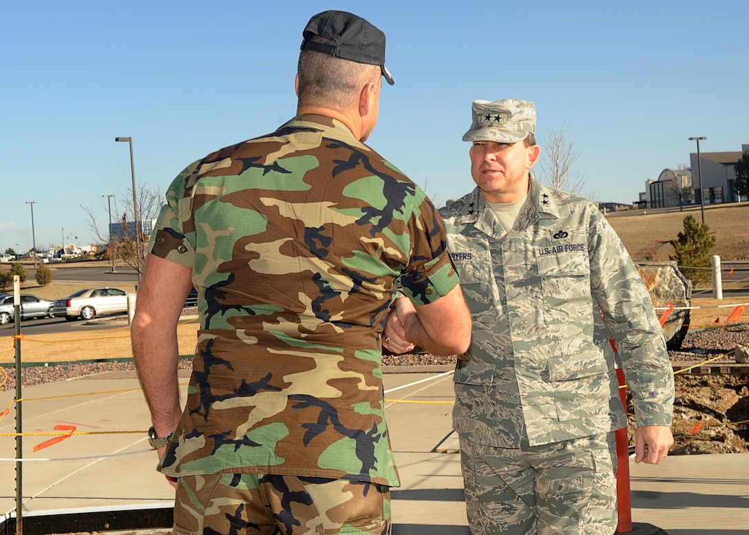 Buckley Air Force Base, Colo.- Maj. Gen. Timothy Byers, Air Force Civil Engineer, and Col. Trent Pickering 460th Space Wing Vice Commander shake hands outside of the Headquarters building Mar 3, 2011. Maj. Gen Byers visited Buckley to inspect the Visitors Quarters/Temporary Lodging Facility.  ( U.S. Air Force Photo by Airman 1st Class Marcy Glass )