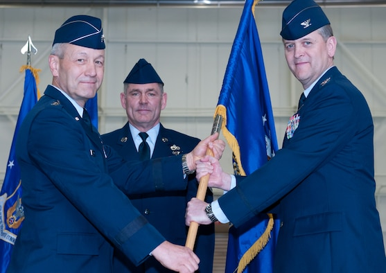 JOINT BASE ANDREWS, Md. -- Maj. Gen. Eric W. Crabtree (far left), 4th Air Force commander, passes the 459th Air Refueling Wing flag to Col. Russell A. Muncy (far right) as Chief Master Sgt. Clifford Van Yahres (center), 459 ARW command chief, looks on in a change of command ceremony here Mar. 5. Colonel Muncy took command of the 459th Air Refueling Wing from Colonel Allman, who retired from the Air Force after 26 years of military service. (U.S. Air Force photo/Staff Sgt. Sophia Piellusch)