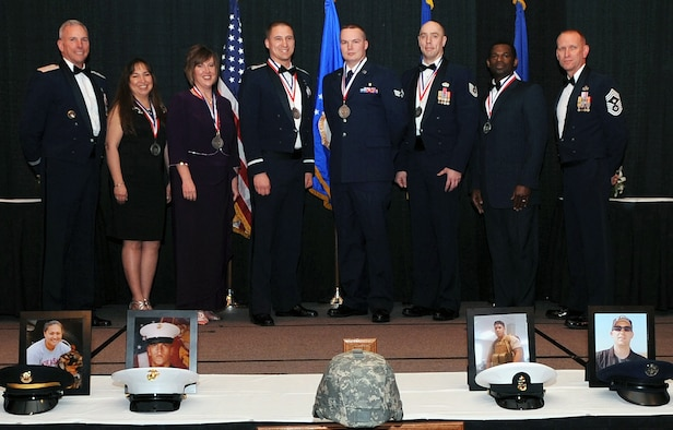 SHREVEPORT, La. - Maj. Gen. Floyd Carpenter (left), Eighth Air Force commander, and Chief Master Sgt. Brian Hornback (right), Eighth Air Force command chief, stand with the Eighth Air Force Outstanding Airmen of the Year: (left to right) Rebecca Smith, 509th Bomb Wing, Whiteman AFB, Mo.; Kelli Kish, representing her husband Master Sgt. Steven Kish, 509th BW; Capt. Michael Pontius, 2nd Bomb wing, Barksdale AFB, La.; Senior Airman Marthinus Taljaard, 2nd BW; Tech. Sgt. Bradley Williams, 5th Bomb Wing, Minot AFB, N.D.; and John Garrett, Headquarters Eighth Air Force, Barksdale AFB. The Eighth Air Force announced their Outstanding Airmen of the Year for 2010 during the Eighth Air Force Outstanding Airmen of the Year Banquet held at the Eldorado Resort and Casino in Shreveport, La., March 3. (U.S. Air Force Photo/Senior Airman La'Shanette V. Garrett)(RELEASED)