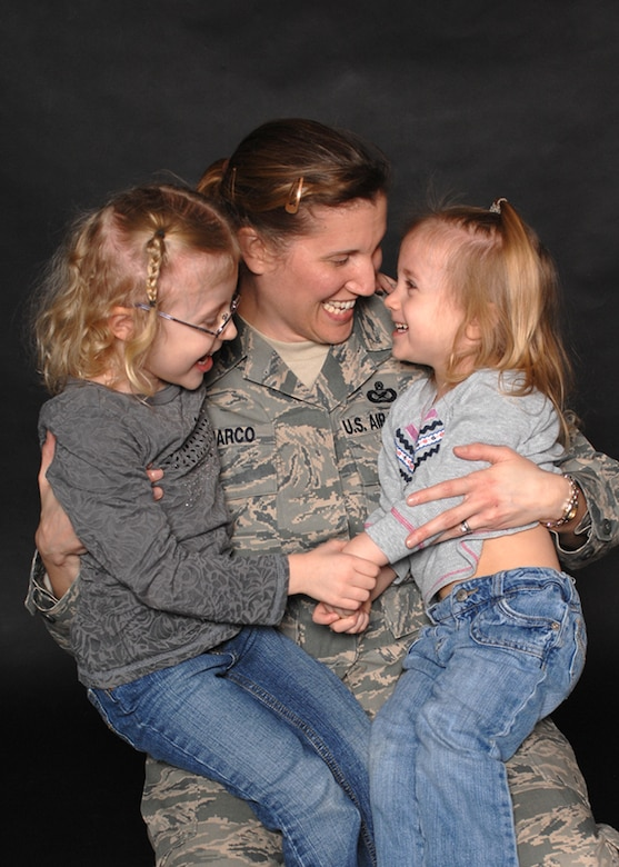"Master Sgt. Tracy DeMarco, with daughters Rachel (left), and Chloe. Sergeant DeMarco shares her thoughts and personal experiences on being a deployed mother in her commentary, ""Deployed moms, every MAJCOM has them"" (U.S. Air Force photo/Staff Sgt. Jerry Fleshman)"