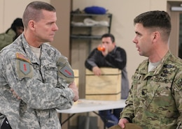 Lt.Col. Michael Katona, commander of the 4th Squadron, 4th Cavalry Regiment and Col. Richard Piscal, 1st Infantry Division Chief of Staff engage in conversation as the 'Pale Riders' wait to set forth their year-long deployment on Feb. 26. The squadron will support Operation Enduring Freedom in Afghanistan. (Photo by SSG Melissa Crawford, 1HBCT PAO)