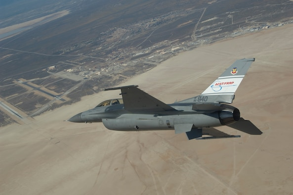 The Automatic Collision Avoidance Technology Fighter Risk Reduction Program F-16 flies over Edwards Air Force Base, Calif. during an Automatic Ground Collision Avoidance System (Auto GCAS) flight test.  This vehicle helped validate Auto GCAS, readying the technology for the planned integration into F-16 production aircraft in 2014.  (NASA photo)