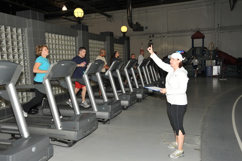 OFFUTT AIR FORCE BASE, Neb. - Marcy Jameson, HAWC Flight Chief & Exercise Physiologist, gestures to participants in the Get Fit Run class at the Offutt Field House.  Mrs. Jameson leads the class every Friday at 6:30 a.m. U.S. Air Force photo by D.P. Heard